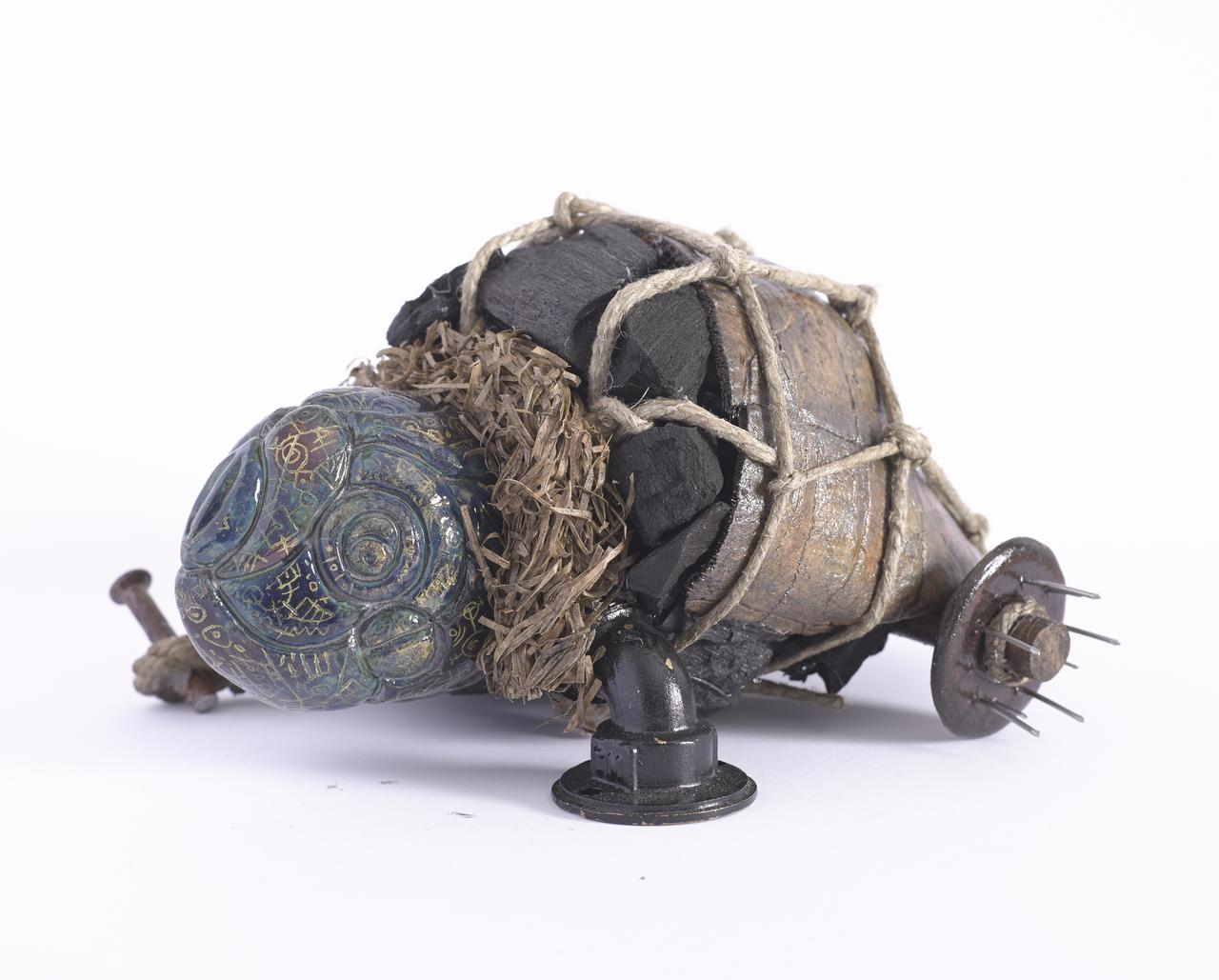 Marios Fournaris, Post-Industrial Artefact  Of The Intercultural Perception N.01,  ceramic, charcoal, wood, iron, jute, hay, brass, 2016