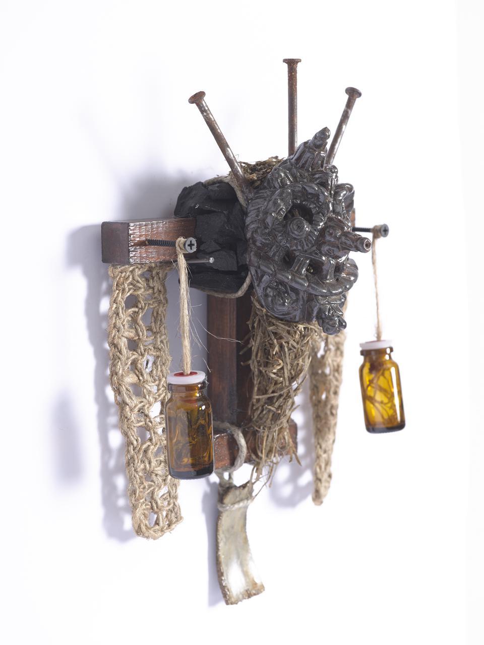 Marios Fournaris, Untitled,  ceramic mask, hay, jute,  bone, glass, wood, iron, charcoal, 2017