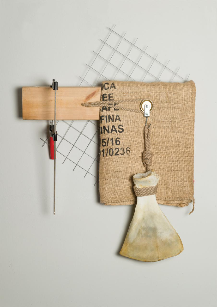 Untitled, 67 cm x 64 cm x 15 cm, wood, iron, woodworking tool, burlap sack, bone, 2018