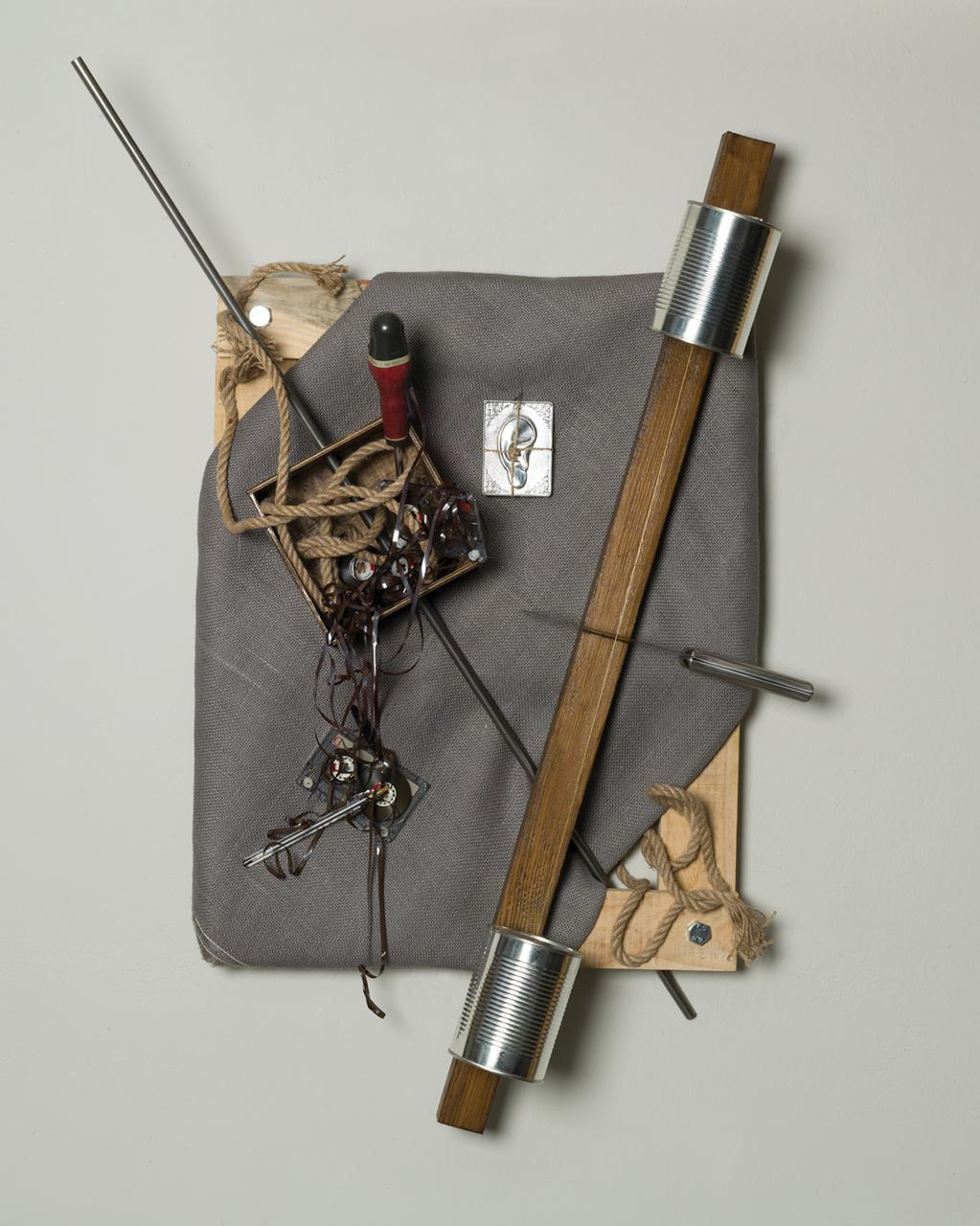 Voice Over, 47 cm x 60 cm x 17 cm, wood, iron, screwdriver, pen, fabric, cleaver, cassettes, old record, juten, rope, aluminium, offering, 2018
