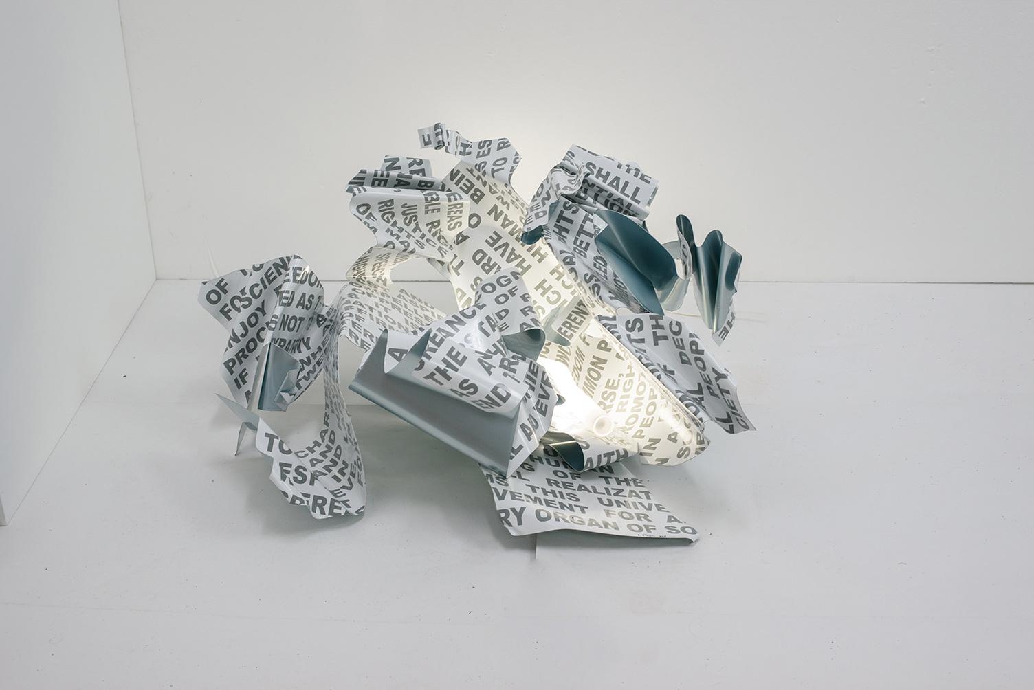 Declaration of Human Rights, Aluminium, print text, light, 85 x 80 x 45 cm, 2018, Trikala